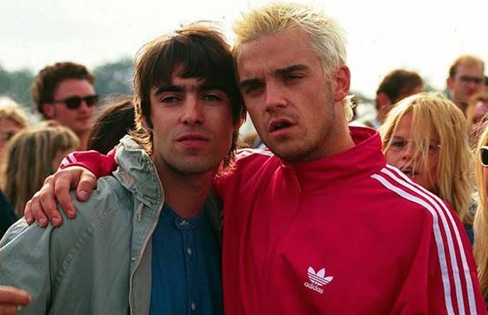 Robbie Williams y Liam Gallagher en el ring